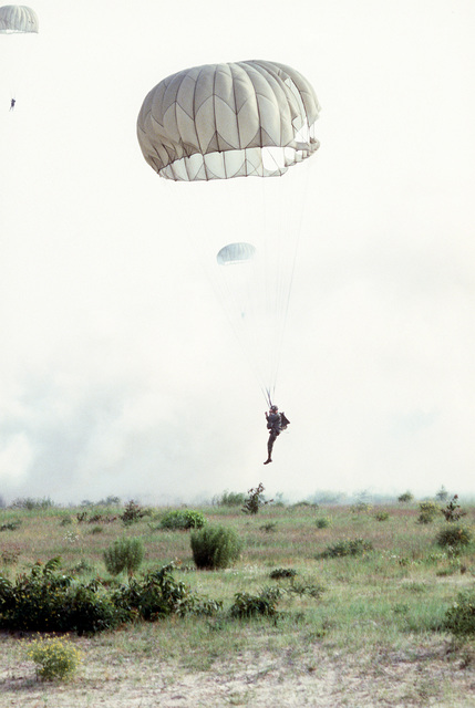 Paratroopers descend after the jump from a C-130 Hercules aircraft during the Volant Rodeo 1981 competition