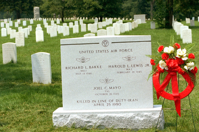 A view of the gravestone of MAJ Richard L. Bakke, MAJ Harold L. Lewis, and TSGT Joel C. Mayo at the Arlington National Cemetery. These men were the Air Force members, who were killed while attempting the rescue of the 50 American hostages held in Iran