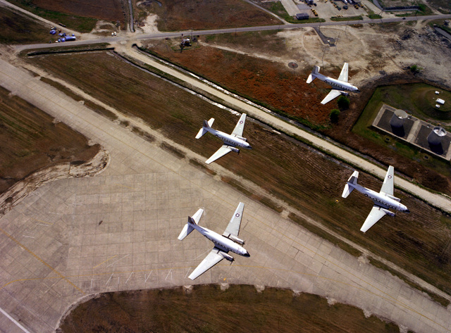 An air to ground view of four Marine C-117 aircraft as they fly over the air station. Marine Corps Air Station, Iwakuni is the only Marine air station that still operates the C-117, which has officially been redesignated R4D-8
