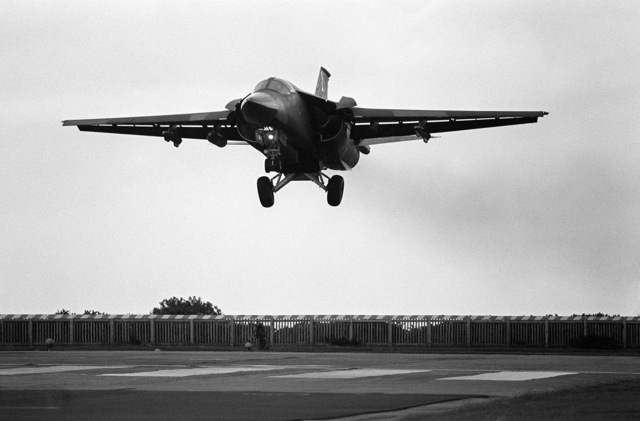 Left front view of an F-111 aircraft coming in for a landing during the Strike Command Tactical Bombing Competition