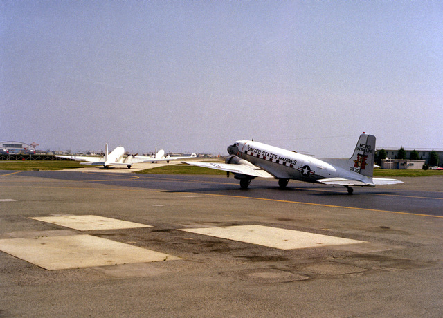 Three of four Marine C-117 aircraft taxi to the runway to prepare for take-off and formation fly over. Marine Corps Air Station, Iwakuni is the only Marine air station that still operates the C-117, which has officially been redesignated R4D-8