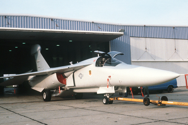 A right front view of an EF-111A aircraft being towed out of a hangar for a rollout ceremony. The aircraft was converted from an F-111 model aircraft at the Grumman Riverhead Plant, Grumman Aerospace Corporation