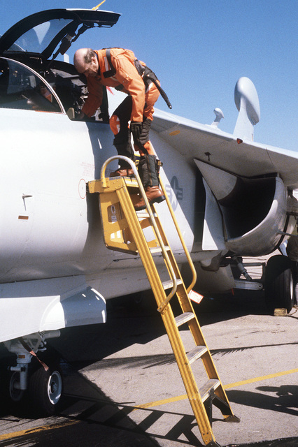 Grumman Aerospace Corporation chief test pilot Chuck Sewell debarks an EF-111A aircraft after the first flight during the rollout ceremony at the Grumman Riverhead Plant, Grumman Aerospace Corp