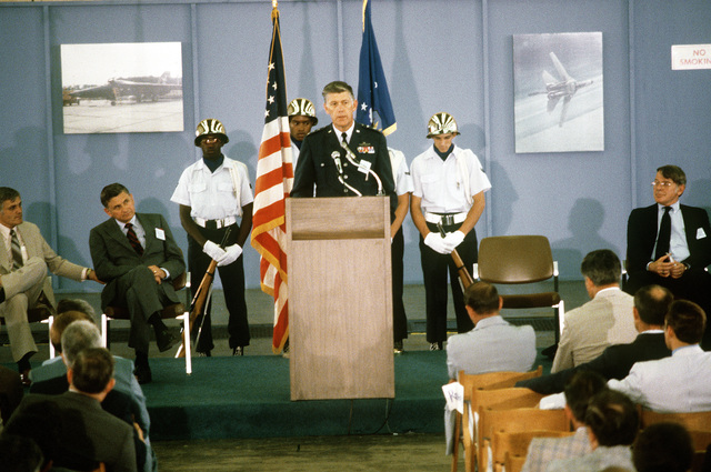 LGEN Lawrence A. Skantze, aeronautical systems division commander, speaks to guests at the rollout ceremony for an EF-111A aircraft at the Grumman Riverhead Plant, Grumman Aerospace Corporation