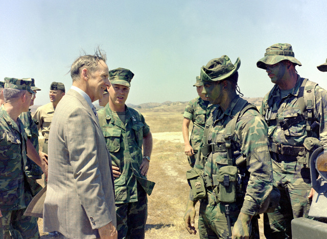 Assistant Secretary of the Navy (Comptroller) D. J. Conn talks with members of Co. A, 1ST Recon. Bn., 1ST Mar. Div., Fleet Marine Force (FMF), while at Basilone Observation Post