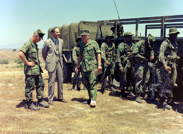 Assistant Secretary of the Navy (Comptroller) D. J. Conn talks with officers and enlisted men of Co. A, 1ST Recon. Bn., 1ST Mar. Div., Fleet Marine Force (FMF), while at Basilone Observation Post