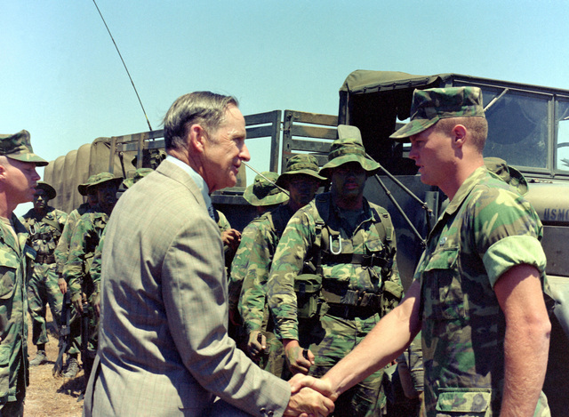 Assistant Secretary of the Navy (Comptroller) D. J. Conn visits Co. A, 1ST Recon Bn., 1ST Mar. Div., Fleet Marine Force (FMF). Conn shakes hands with and talks to one of the platoon leaders while at the Basilone Observation Post