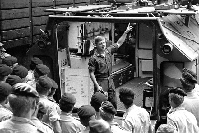 Aboard the dock landing ship, USS PLYMOUTH ROCK (LSD-29), U.S. Marine 1LT William Henderson from Co. K, 3rd Bn., 6th Mar., gives a group of Dutch Marines an orientation on the LVTP-7 tracked landing vehicle, prior to their joint amphibious landing exercise, Unitas XXII, on St. Eustatious