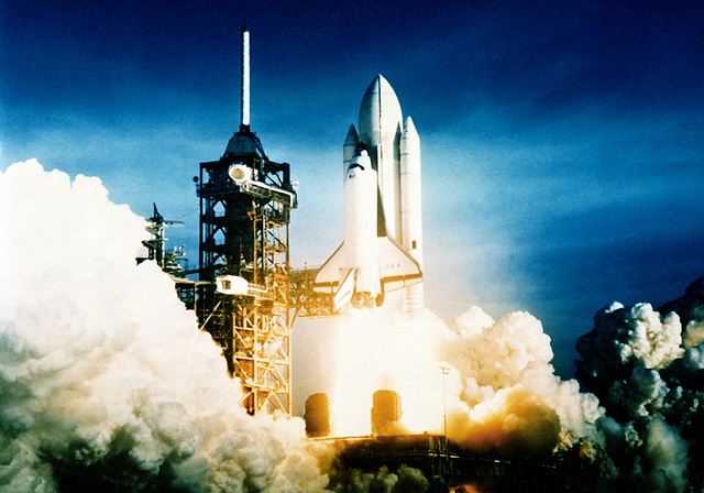 A view of the space shuttle Columbia and its booster rockets at liftoff