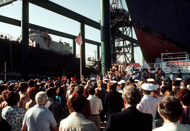 A view of guests and distinguished speakers attending christening and launching ceremonies for the guided missile frigate USS REID (FFG-30) at the Todd Pacific Shipyards Corp., Los Angeles Div