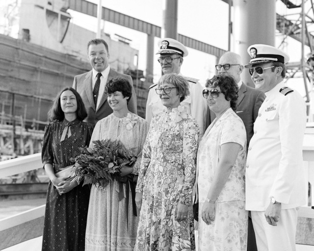 A view of the launching party for the guided missile Frigate RIED (FFG 30) at Todd Pacific Shipyard. First row, left to right: Marcy Abhau, Elliot Abhau, Mrs. William C. Abhau, sponsor, Mrs. David G. Kalb and Captain D.G. Kalb, Second Row: Hans K. Schaefer, Rear Admiral John C. McArthur and retired Admiral William C. Abhau, USN
