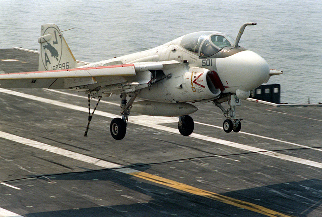 An A-6E Intruder aircraft from Medium Attack Squadron 35 (VA-35) approaches the nuclear-powered aircraft carrier USS NIMITZ (CVN-68) for a landing