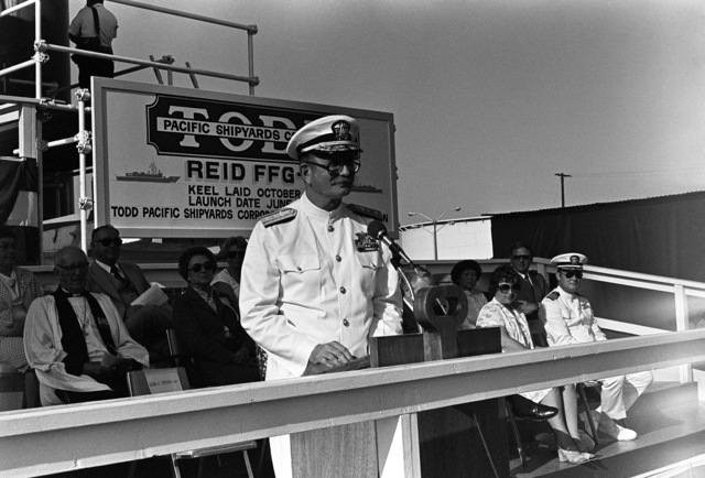 Deputy Commander for Industrial and Facility Management, Naval Sea Systems Command, Rear Admiral John C. McArthur speaks during christening and launching ceremonies for the guided missile frigate USS REID (FFG 30) at the Todd Pacific Shipyards Corp., Los Angeles Division