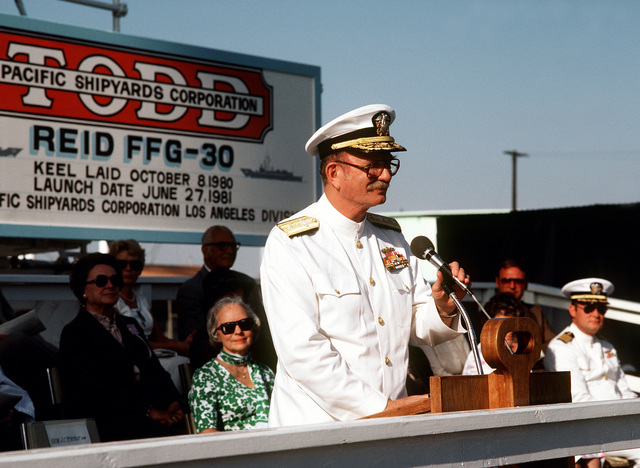 Deputy Commander for Industrial and Facility Management, Naval Sea Systems Command, RADM John C. McArthur, speaks during christening and launching ceremonies for the guided missile frigate USS REID (FFG-30) at the Todd Pacific Shipyards Corp., Los Angeles Div