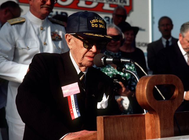 Former Chief of Naval Operations and Survivor from the destroyer ex-USS REID (DD-369), Retired ADM Robert B. Carney speaks during christening and launching ceremonies for the guided missile frigate USS REID (FFG-30) at the Todd Pacific Shipyards Corp., Los Angeles Div