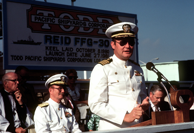 Supervisor of Shipbuilding, Conversion and Repair, CAPT David G. Kalb, speaks during christening and launching ceremonies for the guided missile frigate USS REID (FFG-30) at the Todd Pacific Shipyards Corp., Los Angeles Div