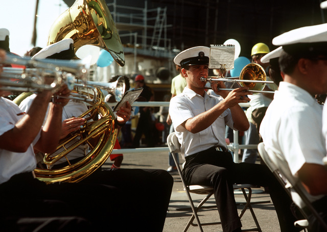 The San Diego Naval Base Band performs during christening and launching ceremonies for the guided missile frigate USS REID (FFG-30) at the Todd Pacific Shipyards Corp., Los Angeles Div