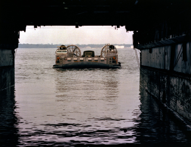 "A bow view of the amphibious assault landing craft (AALC) ""Jeff B"" entering the well deck of the amphibious transport dock USS AUSTIN (LPD 4)"