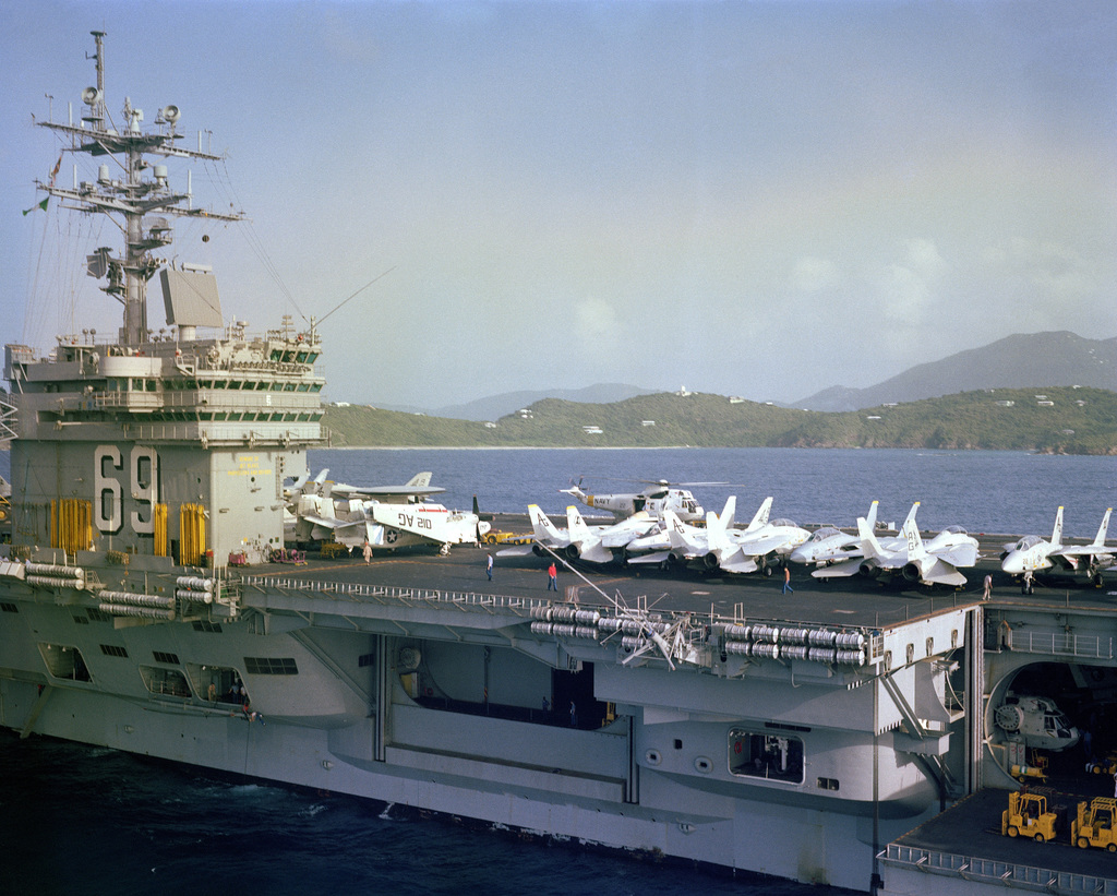 A starboard amidship's view of E-2C Hawkeye and F-14A Tomcat aircraft and an SH-3 Sea King helicopter on the flight deck of the nuclear-powered aircraft carrier USS DWIGHT D. EISENHOWER (CVN 69)