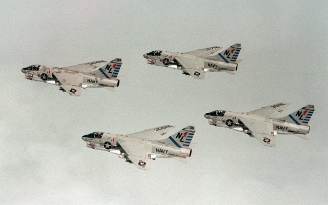An air-to-air left side view of four A-7 Corsair II aircraft from Attack Squadron 22 (VA-22). The Carrier Air Wing 15 (CVW-15) embarked aboard the aircraft carrier USS KITTY HAWK (CV-63)