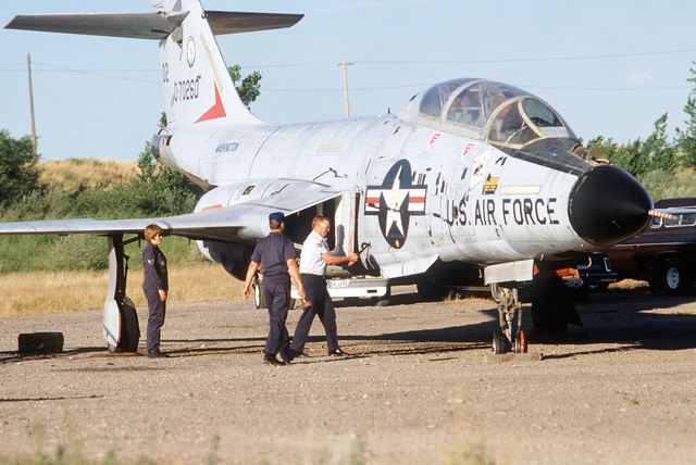 An F-101 Voodoo aircraft is damaged in certain areas, so that personnel from the 2952nd Combat Logistics Support Squadron can repair it as part of a training exercise