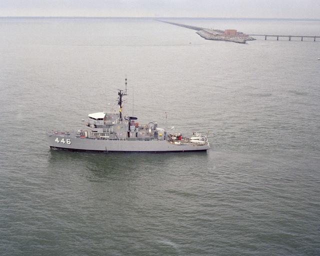 A port beam view of the ocean minesweeper USS FORTIFY (MSO 446) underway