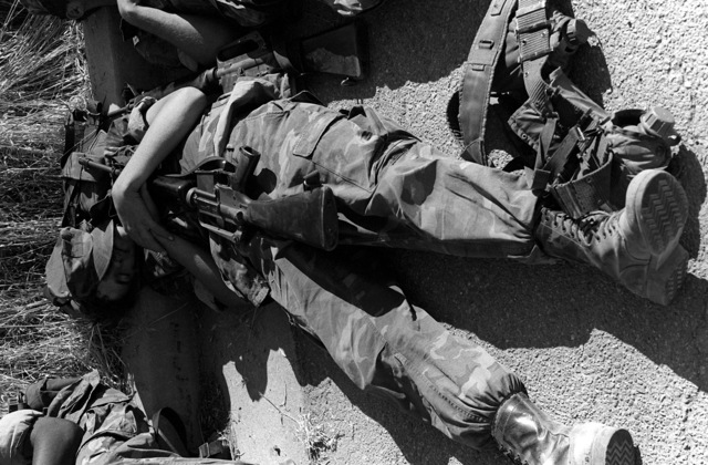 During a break period on a 120-mile hike, LCPL Fred Spurlin, Combat Service Support Detachment 17, takes a quick nap while holding his M-16A1 rifle close. A total of 130 Marines are marching from Twentynine Palms to Camp Pendleton