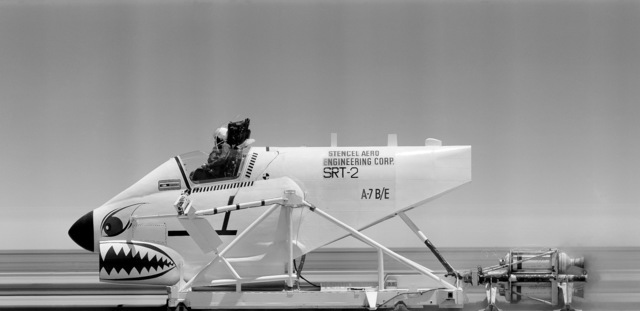 Left side view of an A-7B/E Corsair II aircraft cockpit mounted on a rocket test sled. The model manufactured by Stencel Aero Engineering Corp. is being used to test safety features in the aircraft cockpit