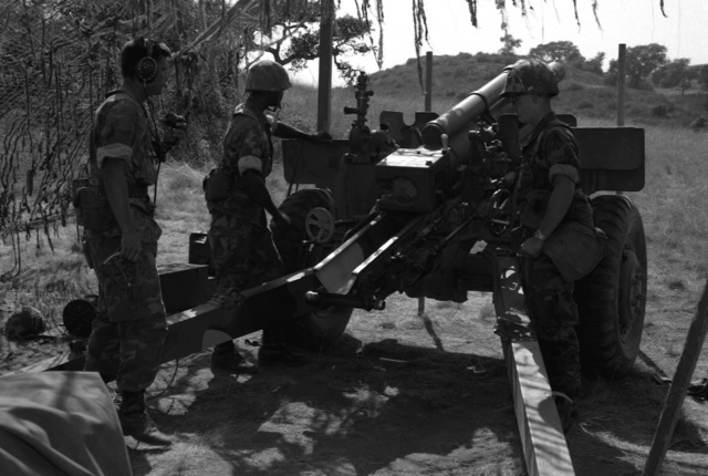 Marines of Btry. A, 1ST Bn., 11th Marines, 1ST Mar. Div., prepare for a fire mission with their 105mm howitzer
