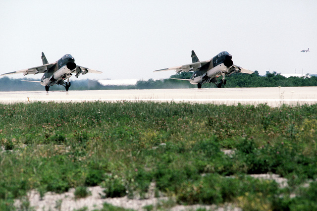 A right front view of two A-7 Corsair II aircraft taking off during exercise Sentry Castle '81. The aircraft are assigned to the 112th Tactical Fighter Group, Pennsylvania Air National Guard