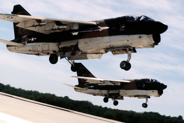 A right side view of two A-7 Corsair II aircraft taking off during exercise Sentry Castle '81. The Corsair to the right is carrying an AIM-9 Sidewinder missile. Both of the aircraft are assigned to the 112th Tactical Fighter Group, Pennsylvania Air National Guard