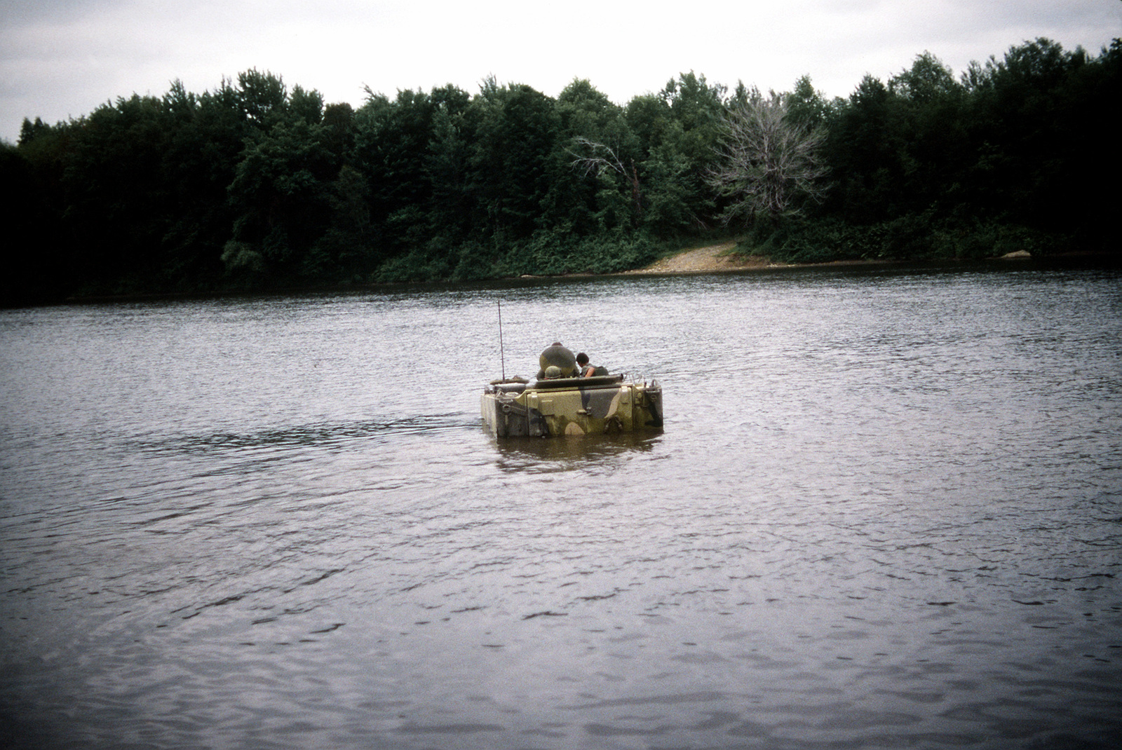 Soldiers aboard an M-113 armored personnel carrier maneuver through a lake in field practice during exercise Sentry Castle '81. The soldiers are assigned to the 42nd Infantry Division, U.S. Army