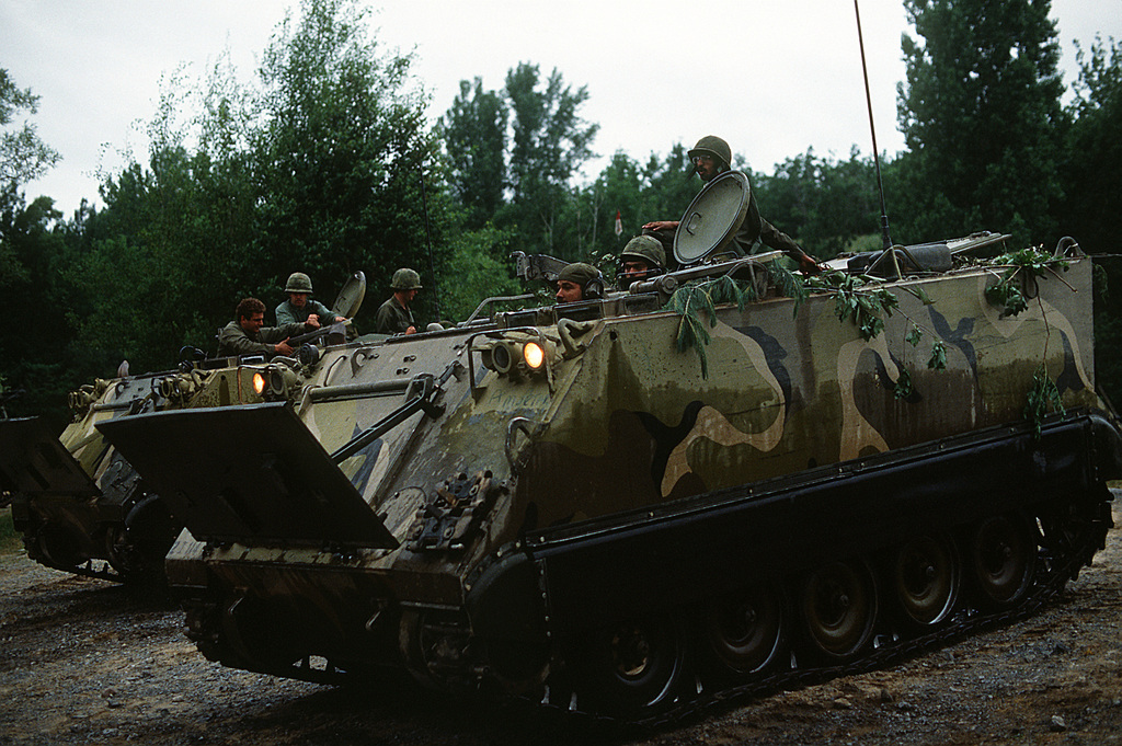 Soldiers aboard an M-113 armored personnel carrier prepare to move out in field practice during Exercise Sentry Castle '81. The soldiers are assigned to the 42nd Infantry Division, U.S. Army
