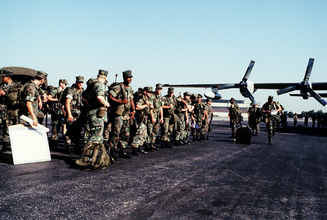Troops from 2nd Bn., 25th Marines, 4th Marine Div., wait to board a C-130D Hercules aircraft for transportation to Fort Drum, N.Y., during Exercise Sentry Castle '81