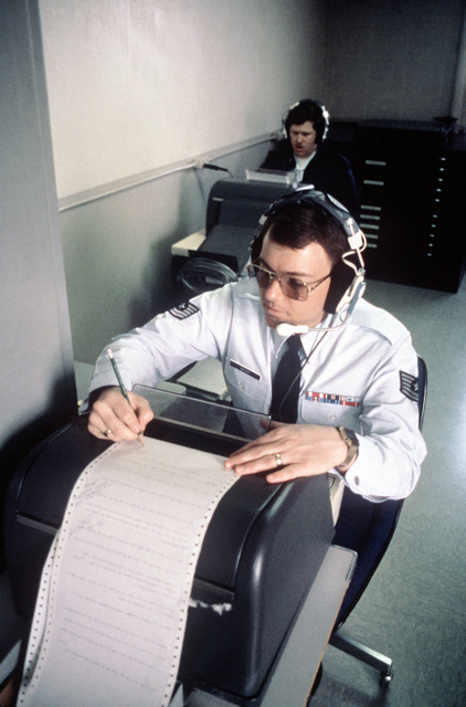 TSGT John Bargar, Outstanding AIRMAN of the Year for 1981, works on a teletypewriter