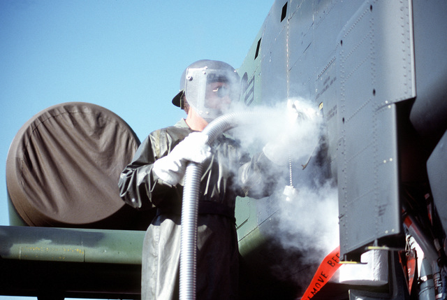 TSGT Phil Morgan supplies an A-10 Thunderbolt II aircraft with liquid oxygen during exercise Sentry Castle '81. The airman is assigned to the 174th Tactical Fighter Wing, New York Air National Guard