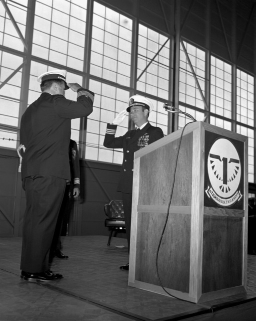 CAPT John M. McNabb, left, and CDR Rodney L. Franz exchange salutes during the change of command ceremony in which Franz is relieving McNabb as commanding officer of Attack Squadron 128 (VA-128)