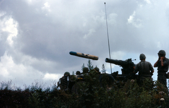 Military personnel fire a tube-launched, optically-tracked, wire-guided (TOW) anti-tank missile during Exercise SENTRY CASTLE '81