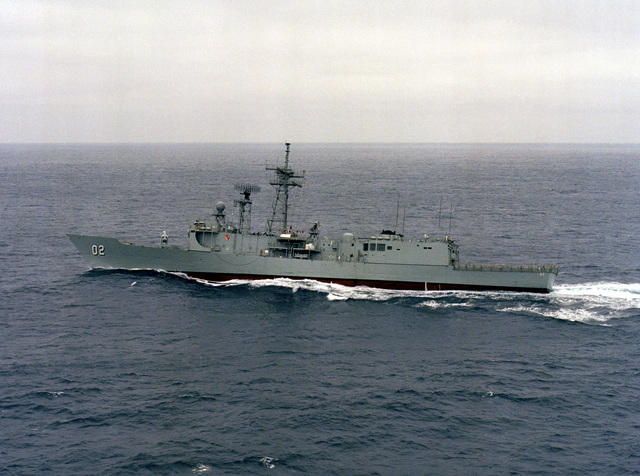 Aerial port beam view of the Australian Frigate HMAS CANBERRA (F-02) during its first Harpoon missile launch near the Pacific Missile Test Center, Point Mugu, California