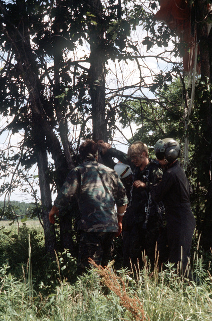 """Members of the 106th Aerospace Rescue and Recovery Group pick up a """"survivor"""", to be transferred aboard an HH-3 Pelican helicopter during Sentry Castle '81, a search and rescue exercise"""