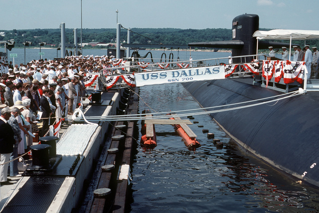 Guests bow their heads for the benediction at the conclusion of the commissioning of the nuclear-powered attack submarine USS DALLAS (SSN 700)