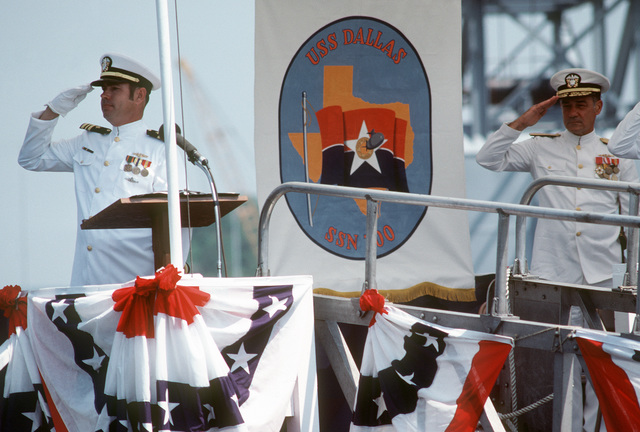 Lieutenant Commander (LCDR) Kenneth R. Mitchum, prospective executive officer, left, and Rear Admiral (RADM) H.L. Young, supervisor of shipbuilding, conversion and repair, salute during the commissioning of the nuclear-powered attack submarine USS DALLAS (SSN 700)
