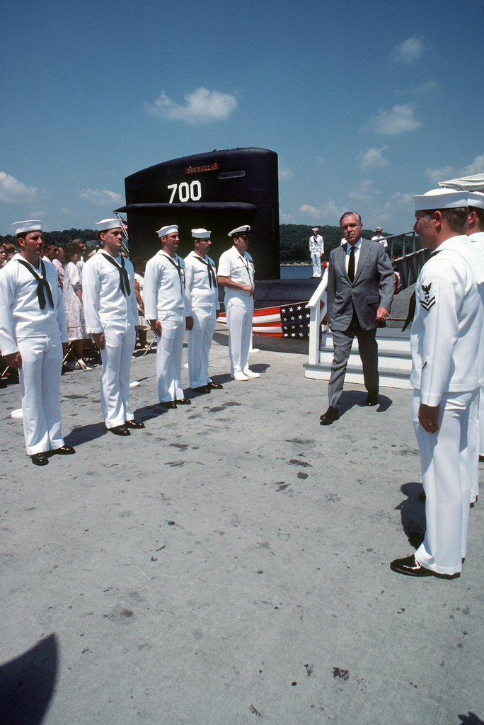 P. Takis Veliotis, executive vice president, General Dynamics, and general manager, Electric Boat Division, passes between two ranks of side boys at the conclusion of the commissioning of the nuclear-powered attack submarine USS DALLAS (SSN 700)
