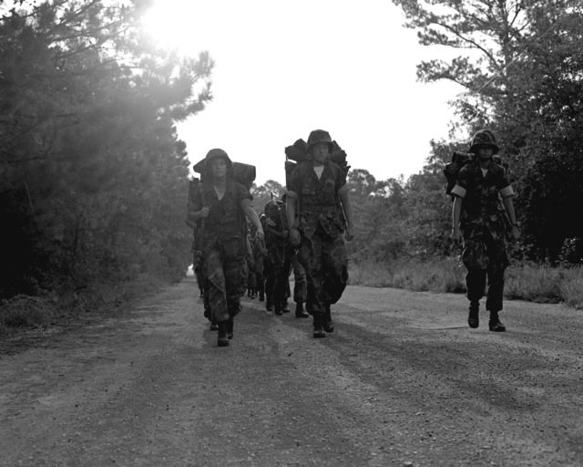 A woman Marine recruit platoon from Series 10, Company K, marches back from a three-day field training exercise held at Page Field, Marine Corps Recruit Depot