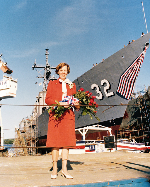 Dr. Susan Hall Hodson, sponsor, stands in front of the Oliver Hazard Perry class guided missile frigate USS JOHN L. HALL (FFG 32), prior to its launch ceremony