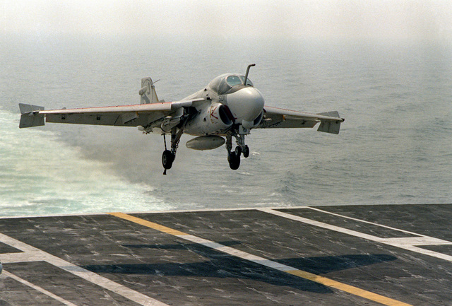 A front view of an A-6E Intruder aircraft coming in for a landing aboard the nuclear-powered aircraft carrier NIMITZ (CVN-68). The aircraft is assigned to Medium Attack Squadron 35 (VA-35) aboard the NIMITZ