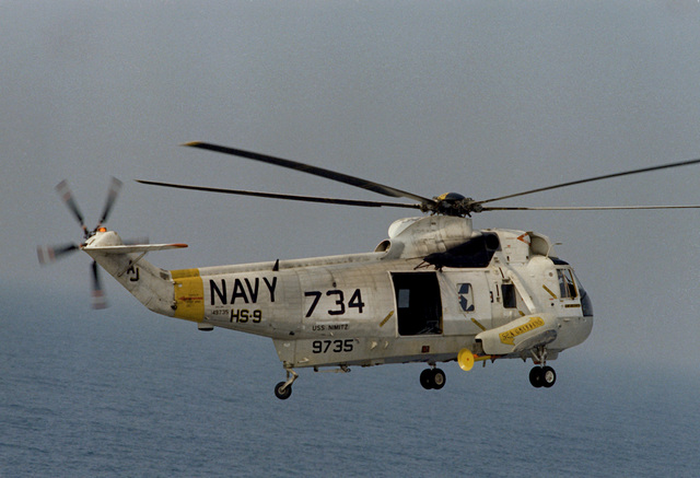 A right view of an SH-3A Sea King helicopter from Helicopter Anti-submarine Squadron 9 (HS-9) assigned to Carrier Air Wing 8 (CVW-8) embarked aboard the nuclear-powered aircraft carrier USS NIMITZ (CVN-68)