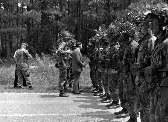 Secretary of Defense Caspar W. Weinberger inspects a rank of combat ready Marines of the 2nd Reconnaissance Battalion. The secretary is touring the 2nd Marine Division