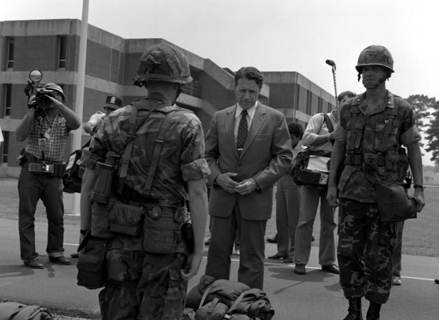 Secretary of Defense Caspar W. Weinberger inspects the men of the Air Alert Force while touring the 2nd Marine Division. Here, the secretary speaks to one of the platoon leaders about his equipment