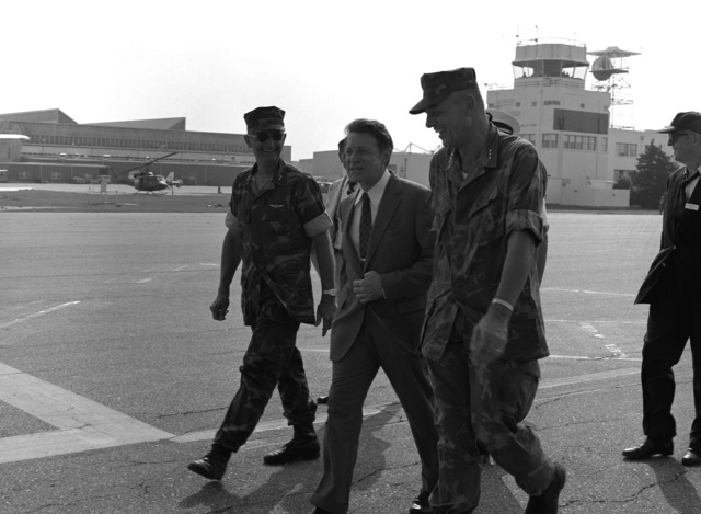 Secretary of Defense Caspar W. Weinberger is met at the Marine Corps air station by LGEN Adolph G. Schwenk, commanding general, Fleet Marine Force, Atlantic, during his tour of east coast Marine Corps units. Weinberger will receive a briefing here and then travel to Camp Lejeune, home of the 2nd Marine Division, Fleet Marine Force